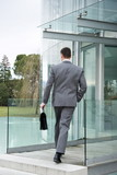 Businessman entering office building