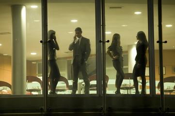 Businessmen and businesswomen in office building
