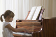 Girl 5-6 playing piano