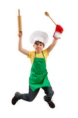 Boy holding kitchenware jumping isolated on white