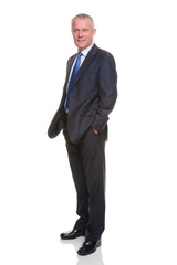 Businessman hands in pockets full length portrait