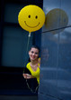 teen girl with smiley balloon