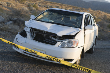 damaged car in desert