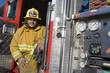 Firefighter sits on fire engine