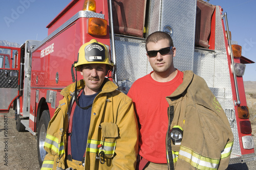 Firefighters in front of truck