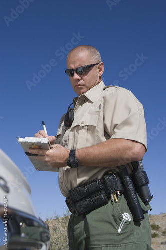 Policeman writing speeding ticket