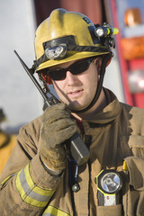 Firefighter holding two-way radio