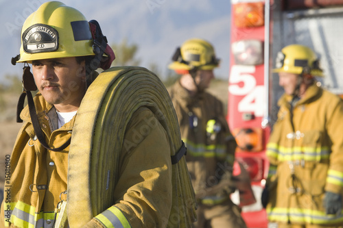 Firefighter carrying hose
