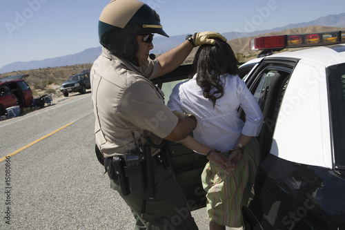 Police officer arrests female driver