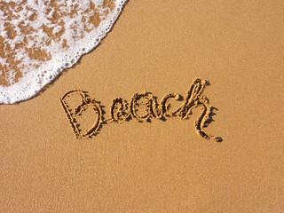 beach, written in the sandy beach