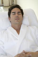 Man sleeping in bathrobe, outdoors