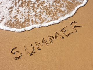 Summer written in the sandy beach
