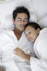Couple sleeping in bathrobes