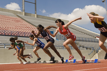 Group of female track athletes sprinting