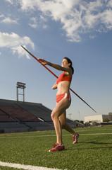 Female athlete throwing javelin