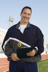 Sports coach on stadium