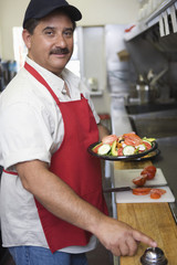Portrait of man working in restaurant kitchen