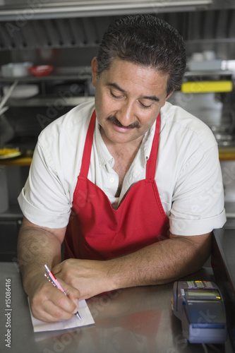 Man writing order in restaurant
