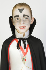 Portrait of boy 7-9 wearing dracula costume for Halloween