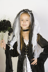 Portrait of girl 7-9 wearing Halloween costume