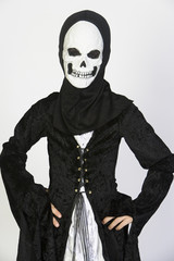 Portrait of child 7-9 wearing skeleton costume