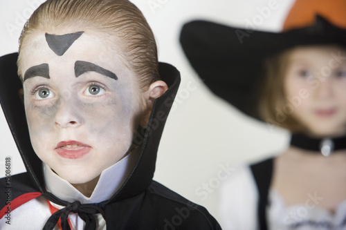 Boy 7-9, wearing dracula costume, girl in background