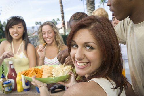 Portrait of Teenage Girl 18-19 at Party, Others in Background