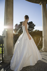 Low angle view of mid-adult bride standing on balcony