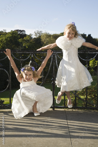 Two girl bridesmaids waiting for wedding ceremony