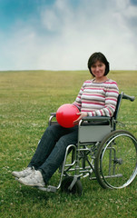 Woman in wheelchair  in park