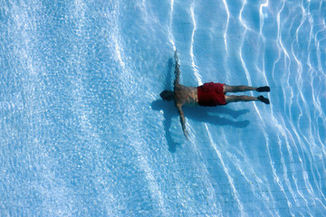 Man in swimming pool, view from above