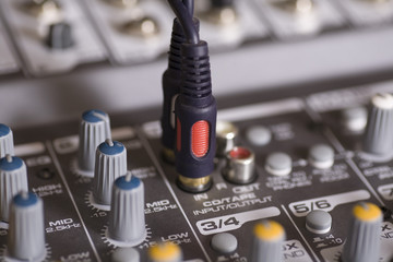 Mixing console with wires plugged in