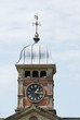 decorative tower with clock, weather vane, & domed roof