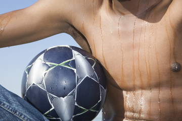 Mans torso with soccer ball