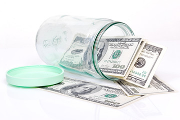 dollar banknotes in the glass jar