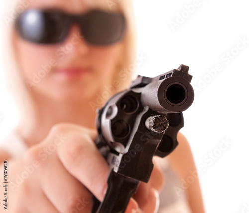 Revolver in hands of sexy woman isolated on white