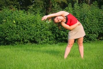 Girl bend right with hand up on grass
