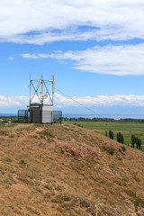 The telecom site on a hill in summer