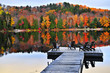 Wooden dock on autumn lake - 15126811