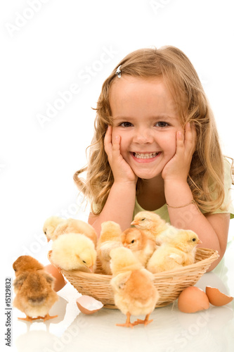 Happy girl with her little chickens