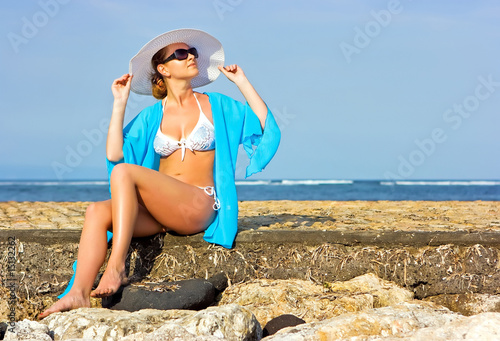 Lady in blue shawl on the beach