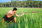warrior with spear in deep green rice paddy poster