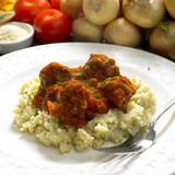 meat balls with couscous in tomato sauce