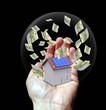 Main dans une bulle avec Maison et billets