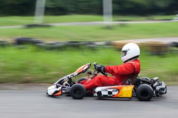 Panning shot of go kart racer