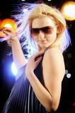 Beautiful blond woman dancing in the nightclub poster