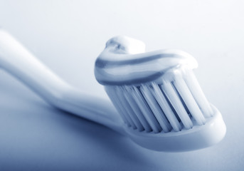 Striped toothpaste on tooth-brush