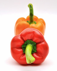 Red and orange capsicum — upright and face