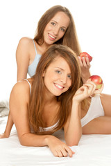 Two teenage girls with apples