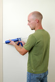 Man caulking a doorway